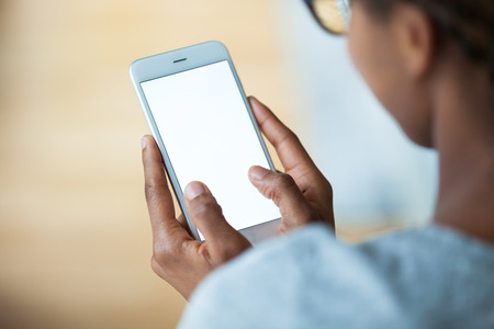 Photo pour African american person holding a tactile mobile smartphone - Black people - image libre de droit