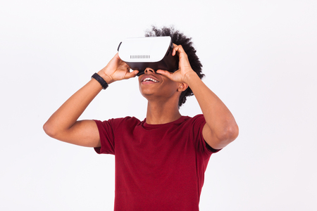 Photo pour African American young man wearing vr virtual reality headset over white background - image libre de droit