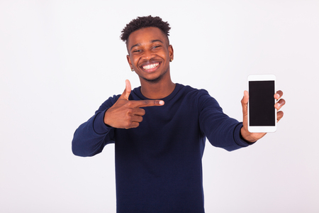 Photo for Young African American man pointing his  smartphone screen - Black teenager people - Royalty Free Image
