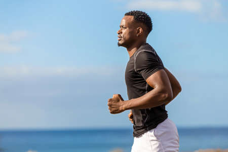 Foto de Black african american young man running outdoor - Imagen libre de derechos