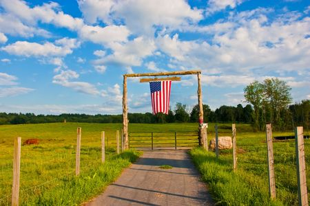 American flag on the gate of farmの写真素材