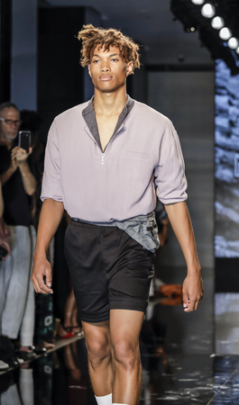 New York, NY, USA - July 12, 2017: A model walks the runway for Matiere Spring/Summer 2018 Runway Presentation during New York Fashion Week: Men's at Cadillac House, NYC