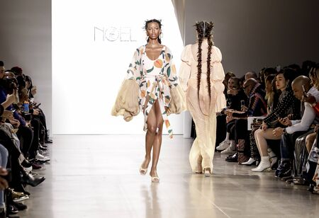 Foto per New York, NY, USA - February 12, 2020: A model walks runway for Fe Noel by Felisha Noel Fall/Winter 2020 Collection during New York Fashion Week at Spring Studios, Manhattan - Immagine Royalty Free