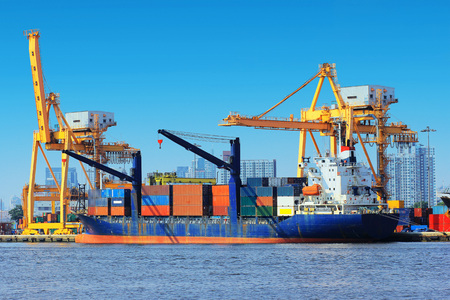 Photo for Container Cargo freight ship with working crane bridge in shipyard. - Royalty Free Image