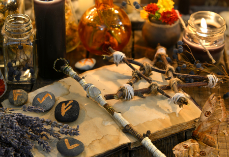Photo pour Runes, magic wand and pentagram on witch table. Occult, esoteric, divination and wicca concept. Halloween vintage background - image libre de droit