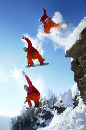 The whole jump of snowboarder from high cliff