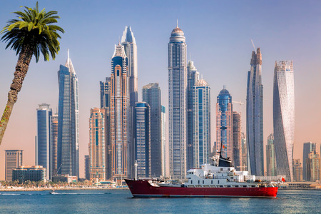 Photo pour Panorama of Dubai with ship against skyscrapers in UAE - image libre de droit