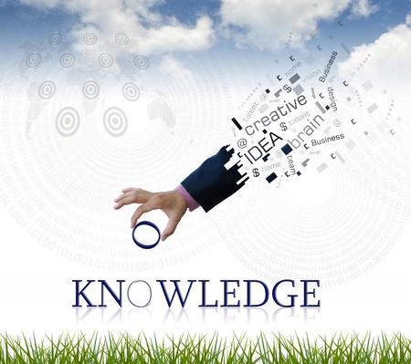 Foto de art work of business hand with the  knowledge  word with nature background. - Imagen libre de derechos