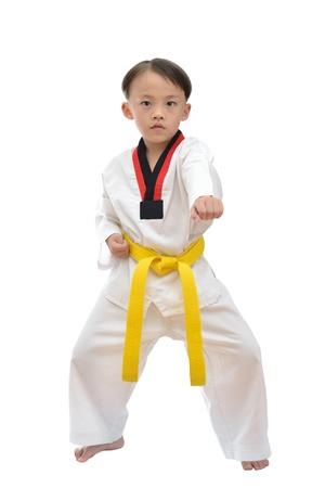Taekwondo boy uniform in action isolated on white background