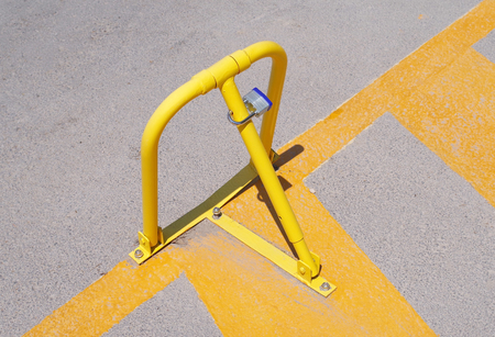 yellow parking barrier on the city car Park