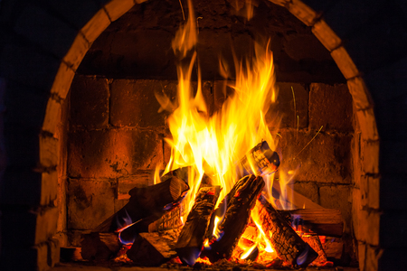 Photo for Wood burning in a cozy fireplace at home, keep warm. - Royalty Free Image