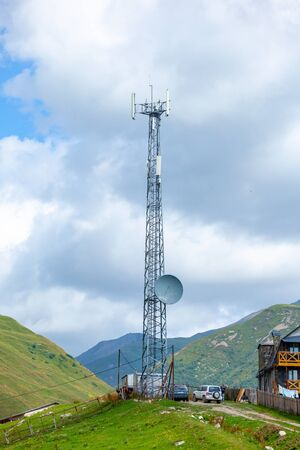 Photo pour Telephone antenna, blue sky and white clouds in Ushguli, Svaneti, Georgia. Telecomunication. - image libre de droit