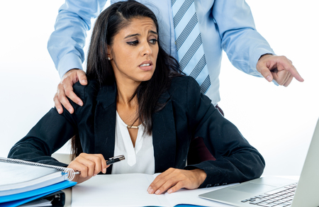 Foto de Uncomfortable scared woman being harass by her boss at office in Sexual harassment at work place, women rights, sexual abuse concept isolated in white background. - Imagen libre de derechos