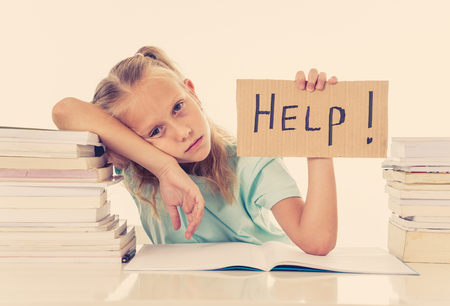 Foto de Frustrated little schoolgirl feeling a failure unable to concentrate in reading and writing difficulties learning problem attentional disorders special needs and low academic performance concept. - Imagen libre de derechos