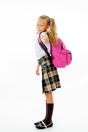 Photo pour Pretty cute blonde hair girl with a pink schoolbag looking at camera showing thumb up gesture happy to go to school isolated on white background in back to school and children education concept. - image libre de droit