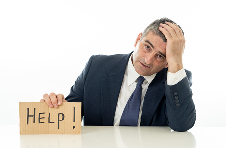 Photo pour Helpless mature businessman holding a help sign in financial crisis unemployment stress and depression concept isolated in white background. - image libre de droit