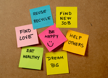 Photo pour New Year's resolution written on cork board with colorful memo notes of dreams wishes and trendy lettering post its for happy life style Goals and self management motivation concept. - image libre de droit