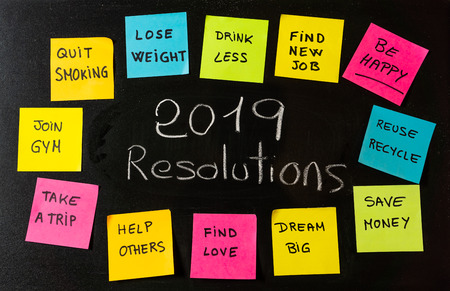 Photo pour 2019 Goals or New Year's resolution written with chalk on blackboard with colorful notes of dreams wishes and trendy lettering post its for happy life and self management motivation concept. - image libre de droit