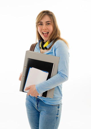 Photo pour Beautiful teenager girl or young college student woman with backpack and folder smiling feeling happy and cheerful. Isolated on white background. University lifestyle success and end of school year. - image libre de droit