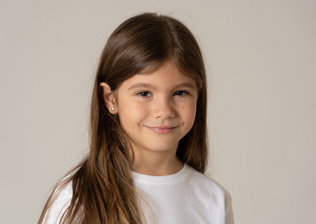 Photo pour Cute happy, confident, successful, proud little girl smiling at the camera. Positive human emotions and facial expressions, children and education concept. Studio shot with copy space. - image libre de droit