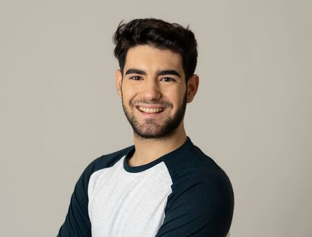 Photo for Positive human facial expressions and emotions. Portrait of handsome young male in his 20s with happy face smiling and making cheerful gestures at the camera. Close up Isolated on neutral background. - Royalty Free Image