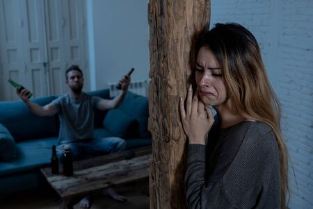 Photo pour Social issues Domestic violence concept. Young couple having arguments and problems with alcoholic husband. Man threatening scared wife or girlfriend terrified of aggression and domestic abuse. - image libre de droit