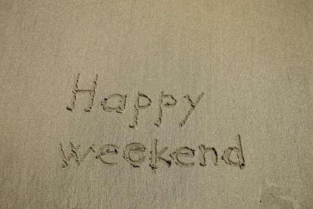 Photo pour happy weekend written on a tropical white sand beach - image libre de droit