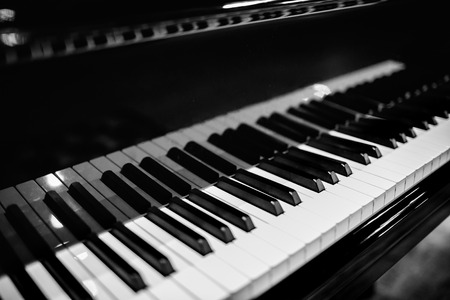 Photo for Piano keyboard with glossy black and white keys  - Royalty Free Image