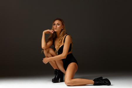 Photo pour Elegant female dancing striptease dance - image libre de droit