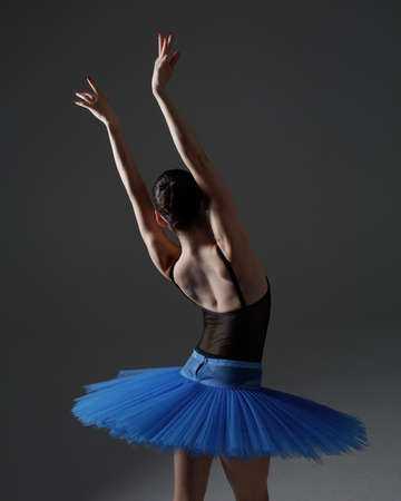 Photo pour Young beautiful ballerina is posing in studio - image libre de droit