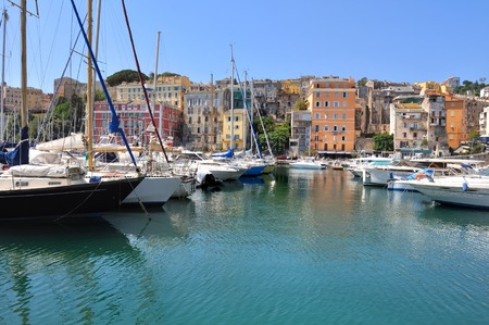 pleasure boats in the port of Bastia with its colorful buildings - Corsica