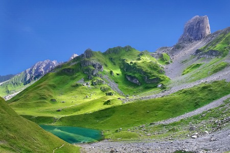 beautiful landscape of rocky and greenery mountain with a lake