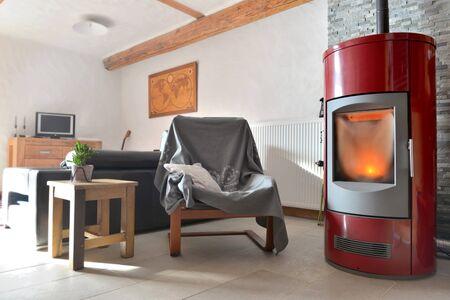 Photo pour red stove pellet in a living room - image libre de droit