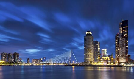 Rotterdam skyline during the blue hour. With the Erasmus bridge Holland-America Line New o