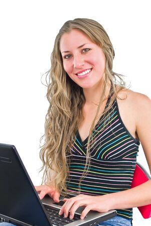 smiling office girl typing on laptop