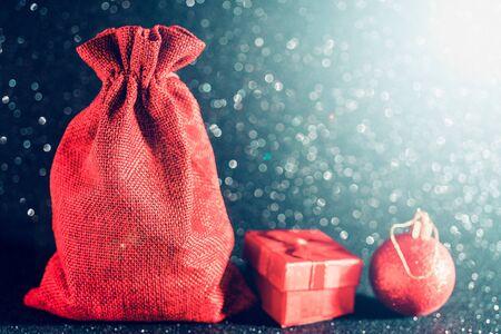 Photo pour Christmas shiny black background. Red gift bag and Christmas toys. - image libre de droit