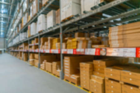 Photo for Blurred background of the warehouse. Boxes with goods on the shelves. - Royalty Free Image