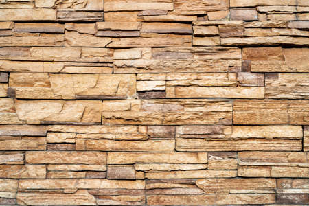 Photo pour Wall of yellow stone. Abstract natural background. Uneven stone surface. - image libre de droit