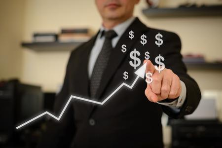 Foto de Business man showing success chart. This image represents positive thinking and plans for financial growth, success and victory. - Imagen libre de derechos