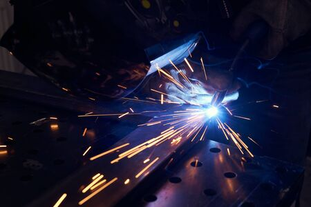 Photo for worker with protective mask welding metal closeup. - Royalty Free Image