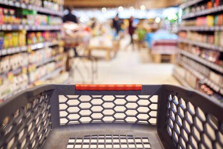 Foto für Abstract blurred photo of empty trolley in supermarket bokeh background. Empty shopping cart in supermarket. - Lizenzfreies Bild