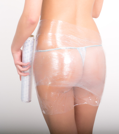 Photo for Cosmetic wrap. Slimming treatment in certain parts of the body. Caring for female body. - Royalty Free Image