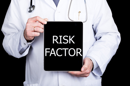 technology, internet and networking in medicine concept - Doctor holding a tablet pc with risk factor sign. Internet technologies in medicine.