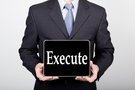 technology, internet and networking in business concept - businessman holding a tablet pc with execute sign. Internet technologies in business.