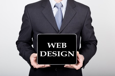 technology, internet and networking in business concept - businessman holding a tablet pc with web design sign. Internet technologies in business.