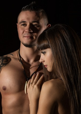 Photo for seductive portrait of pretty sexy couple in love hugs on dark background - Royalty Free Image