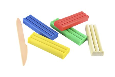 Children set of colored pieces of plasticine and a plastic knife for sculpting