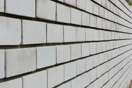 Have just laid out the wall of white brick in cement mortar in perspective