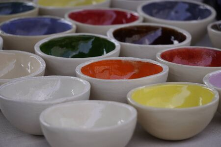 Photo pour the small ceramic colored plates, dishes for spices, dessert. handmade, pattern - image libre de droit