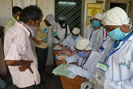 Photo pour Burdwan Town, Purba Bardhaman District, West Bengal / India - 14.05.2020: Homeopathic medicine 'Arsenicum Album 30' is being distributed free of cost to increase immunity against Novel Coronavirus (COVID-19) under the direction of the Ministry of AYUSH, G - image libre de droit